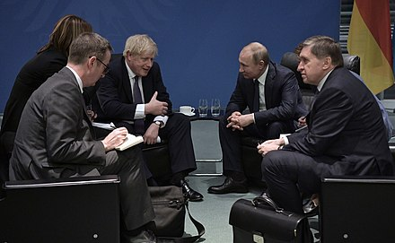 UK Prime Minister Boris Johnson (left) tested positive for COVID-19 in March 2020. Russian President Vladimir Putin (right) began working remotely from his office at Novo-Ogaryovo after meeting with an infected doctor.