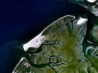 Holmes's Bonfire - Satellite image of Vlieland, with the Vlie estuary to the north; despite it being flood tide, the mudflats are visible below the water surface