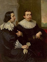 Portrait of two men with gloves.