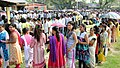 Voters wait in queues to cast their votes, at a polling booth, during the 2nd phase of Assam Assembly Election, at Maidamgaon, Bakarapara, Basistha, in Kamrup district on April 11, 2016.jpg