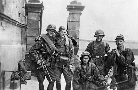 Soldiers of Kedyw Kolegium A on Stawki Street in Warsaw's Wola district, Warsaw Uprising, 1944 Warsaw Uprising by Deczkowki - Kolegium A -15861.jpg