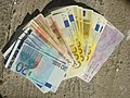 Wealth in colorful banknotes.jpg