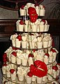 White Chocolate Cups Cake with Red Lillies.jpg