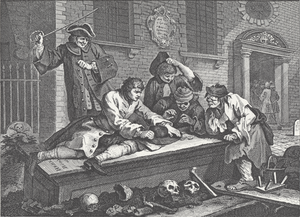A group of people gambling on a flat tombstone. Scattered human remains are strewn on the ground around them.