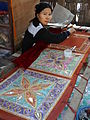 Woman Works on Fine Embroidery.jpg