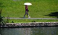 Woman walking with umbrella, Palace of Fine Arts, San Francisco - 2007-07-28 (4889300377).jpg