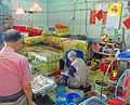 Woman working in wet market in Peng Chau, Hong Kong.jpg