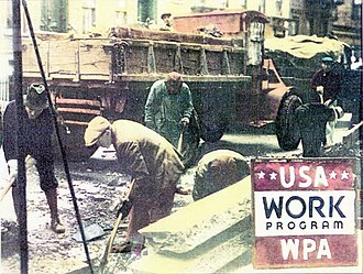 "Workers digging in a street with their shovels; a red truck is seen in the background and ""USA Work Program WPA"" is spelled out in the lower right."