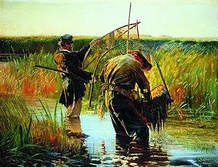 Rybacy brodzący po wodzie