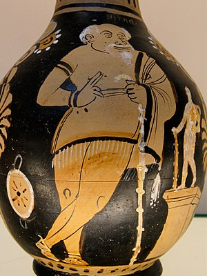 The Frogs - Red-figure vase painting showing an actor dressed as Xanthias in The Frogs, standing next to a statuette of Heracles