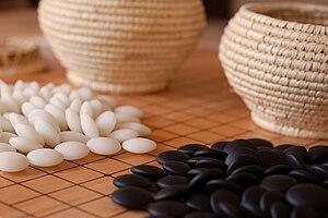 Yunzi - Double convex yunzi stones and woven baskets