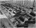 """""""View from the Westmix platform showing concrete blocks under construction above the downstream placing trestle."""" - NARA - 294296.tif"""