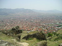 the red-roofed buildings of Prilep and surrounding mountains and vallies