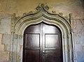 051 Sant Jeroni de la Murtra, galeria sud del claustre, porta del Sant Crist.JPG