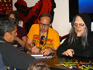 Creepy (magazine) - Editor Dan Braun signs a collected edition of Creepy next to a model dressed as Uncle Creepy at the Dark Horse Comics booth at the 2011 New York Comic Con.