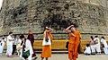 12. Religious Ceremony taking place at the Dhamek Stupa, Sarnath.jpg