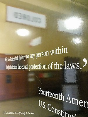"Brown v. Board of Education National Historic Site - Quote from the 14th Amendment just inside the Monroe School entrance. The ""Colored"" and ""White"" signs from the segregationist era are reflected in the Amendment."