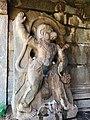 15th-16th century Madhava Ranga temple colossal Hanuman standing with waist dagger over a demon, Hampi Hindu monuments Karnataka.jpg