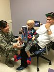 163rd Reconnaissance Wing delivers holiday cheer to children's hospital 131217-Z-UF872-014.jpg