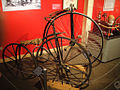 1869 Hanlon Brothers boneshaker and 1885 Victor high wheel.jpg