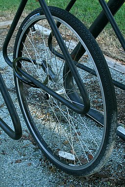 A bicycle wheel remains chained in a bike rack after the rest of the bicycle has been stolen at east campus of Duke University in Durham, North Carolina. 2008-09-06 Solitary bicycle wheel in a bike rack.jpg