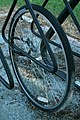 2008-09-06 Solitary bicycle wheel in a bike rack.jpg