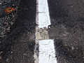 2014-08-29 13 03 08 Fresh white road paint laid on top of old paint and a now-removed piece of debris on Tabernacle-Chatsworth Road (Burlington County Route 532) in Woodland Township, New Jersey.JPG