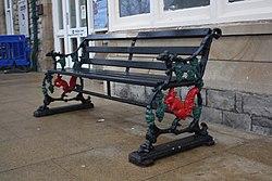 2018 at Grange-over-Sands station - old Furness Railway bench.JPG
