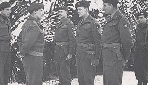 Edwin Flavell - Flavell (third left) with fellow Brigadiers James Hill and Nigel Poett talking to Field Marshal Montgomery during the Battle of the Bulge, January 1945.
