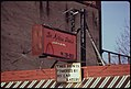 A-car-battery-operated-this-neon-advertising-sign-over-a-business-during-the-energy-crisis-in-december-1973-121973 4271738741 o.jpg