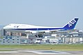 ANA B747-481D touch down to Fukuoka Airport RWY 16 (234678993).jpg