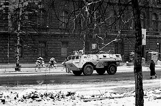 United Nations Security Council Resolution 769 - UNPROFOR armoured personnel carrier passes the Presidency Building in Sarajevo