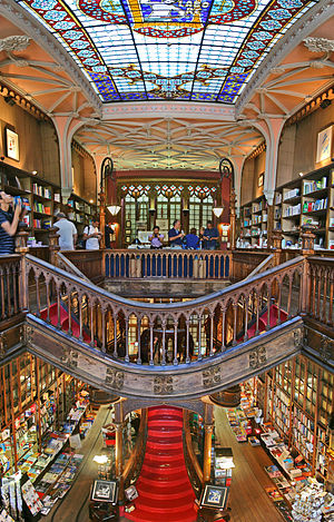 Livraria Lello - The interior of the store, showing skylight, staircase and book shelves