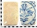 A Post Medieval incomplete London Delftware (tin-glazed earthenware) floor tile, blue on white design (c.1650-1700). (FindID 286473).jpg