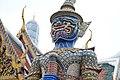 A giant statue in the Temple of the Emerald Buddha Wat Phrasrirattana Sasadaram (Wat Phra Kaeo).jpg