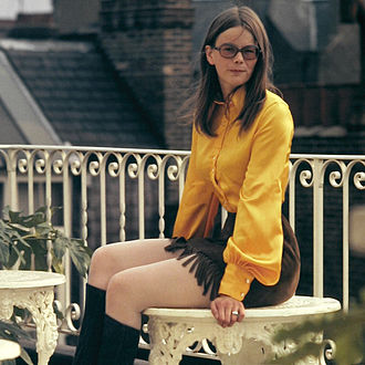 1970s in Western fashion - By the early 1970s, miniskirts had reached an all-time popularity. This young English woman is wearing a fringed suede miniskirt.