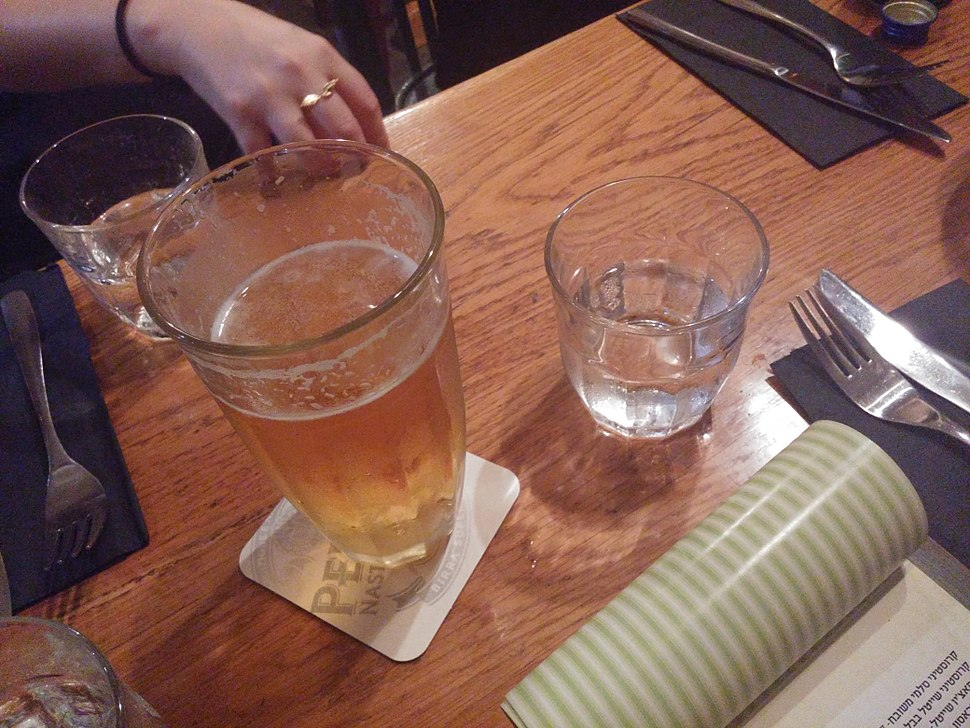 A glass of beer on a wooden table (1)
