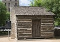A replica in downtown Dallas, Texas, of the 1842 pioneer cabin of John Neely Bryan, a Tennessee settler who founded the city LCCN2014632145.tif