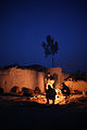 Afghan National Army commandos with the 3rd Company, 3rd Special Operations Kandak stand by a fire to stay warm as the in Bahlozi, Maiwand district, Kandahar province, Afghanistan, Jan. 1, 2014 140101-A-LW390-412.jpg