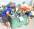 Airmen spread holiday cheer during Operation Christmas Drop sorting party 151204-F-IX728-073.jpg
