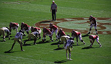 American football players lined up prior to a play