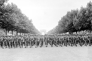 Victory parade - American troops of the 28th Infantry Division march down the Avenue des Champs-Élysées, Paris, in the Victory Parade.