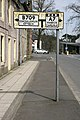 An old style road sign at Langholm - geograph.org.uk - 1825106.jpg