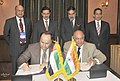 Anand Sharma and the Minister of Economy, UAE, Sultan bin Sayeed Al Mansouri witnessing the signing of Memorandum of Understanding between Kohinoor Foods and Al Dhara Agri of UAE, on the sidelines of the Partnership Summit.jpg