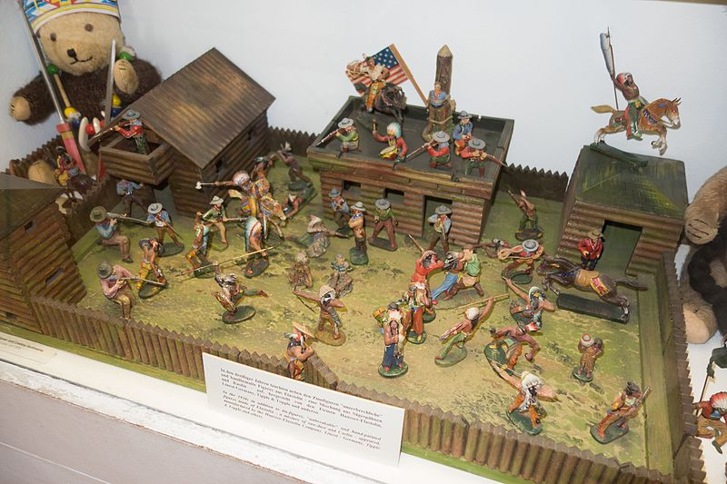 File:Antique toy cowboys and indians in wooden fort (26868660191).jpg