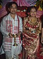 Assamese bride and groom in traditional attire.jpg