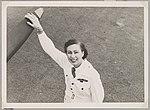 Australian Women Pilots' Association member Nancy Leebold (nee Ellis) in flying suit holding onto an aeroplane's propeller, May 1954 (16102215278).jpg