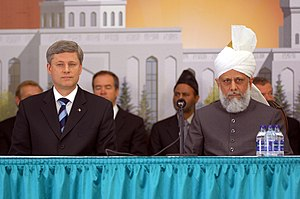 Baitun Nur Mosque - Prime Minister Stephen Harper (left) seated with Mirza Masroor Ahmad (right) at the grand opening of the Baitun Nur mosque to the public on July 5, 2008