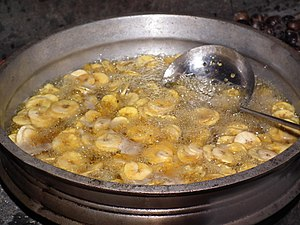 Banana chip - Banana chips being prepared by deep frying