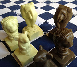 A selection of Barca playing pieces on Barca board.